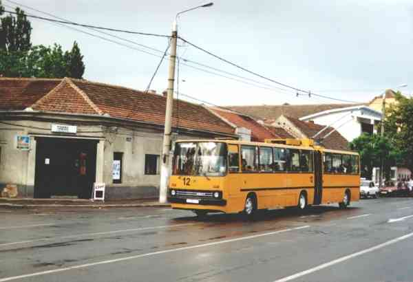 Former Eberswalde articulated trolleybus no. 020 of the Hungarian type Ikarus 280.93 in Timisoara/RO with the car no. 12 on 31 May 2001